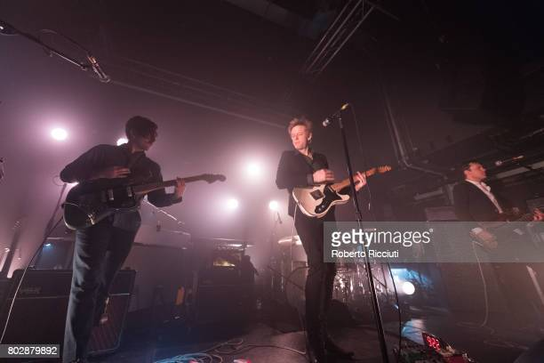 Alex Fischel Britt Daniel and Rob Pope of Spoon perform on stage at The Art School on June 28 2017 in Glasgow Scotland