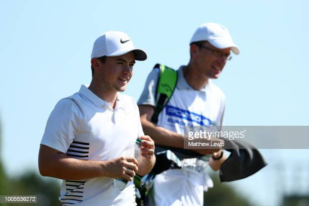 Alex Fitzpatrick of England looks on with his caddy during day one of Porsche European Open at Green Eagle Golf Course on July 26 2018 in Hamburg...