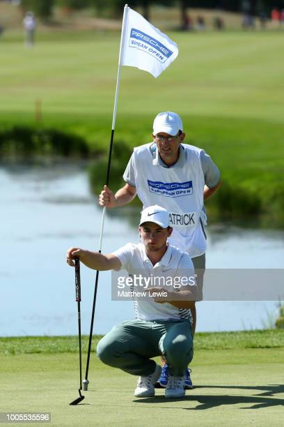 Alex Fitzpatrick of England looks on with his caddy on the 15th green during day one of Porsche European Open at Green Eagle Golf Course on July 26...