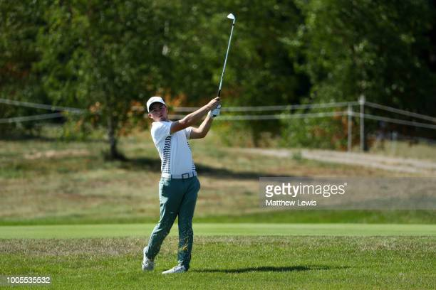 Alex Fitzpatrick of England plays his second shot on the 15th green during day one of Porsche European Open at Green Eagle Golf Course on July 26...