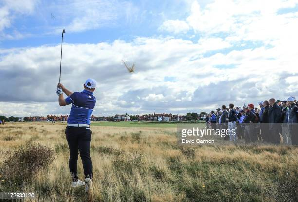Alex Fitzpatrick of the Great Britain and Ireland team plays his second shot on the 16th hole in his match with Conor Purcell against John Augenstein...