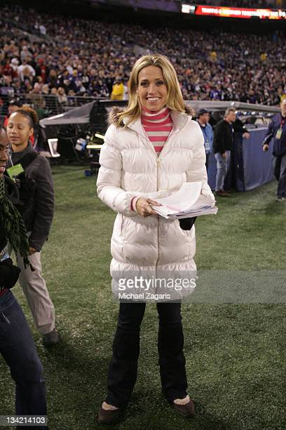 Alex Flanagan of the NFL stands on the sideline during the game between the San Francisco 49ers and the Baltimore Ravens at MT Bank Stadium on...