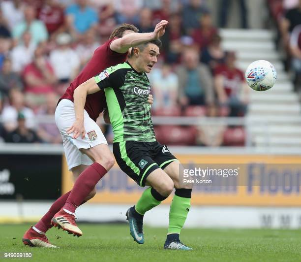 Alex Fletcher of Plymouth Argyle attempts to control the ball under pressure from Ash Taylor of Northampton Town during the Sky Bet League One match...