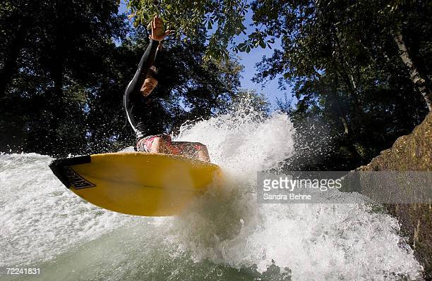 Alex Foerderer one of Munich's Isar River Surfers surfs on the Eisbach on October 10 2006 in Munich Germany The history of surfing the Eisbach goes...