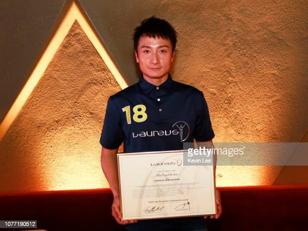 Alex Fong Lik Sun poses with the certificate before the Laureus Hong Kong Ambassador Announcement ceremony at Mercedes Me Store on December 04 2018...