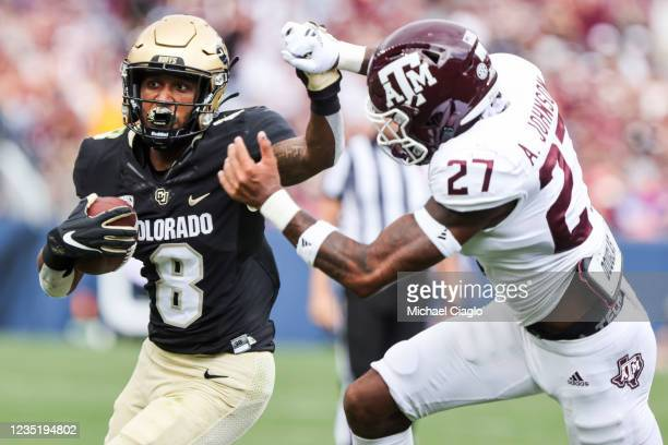 Alex Fontenot of the Colorado Buffaloes makes a run while being defended by Antonio Johnson of the Texas A&M Aggies during the second quarter at...