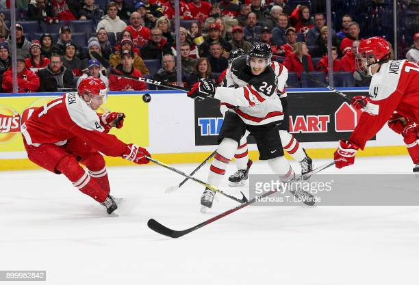 Alex Formenton of Canada shoots the puck past Christian Larsen of Denmark during the first period of play in the IIHF World Junior Championships at...