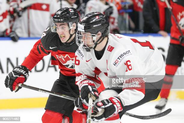 Alex Formenton of Canada skates past Nico Gross of Switzerland during the first period of play in the Quarterfinal IIHF World Junior Championship...