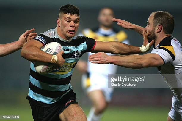Alex Foster of London Broncos hands off Liam Finn of Castleford during the Super League match between London Broncos and Castleford Tigers at The...
