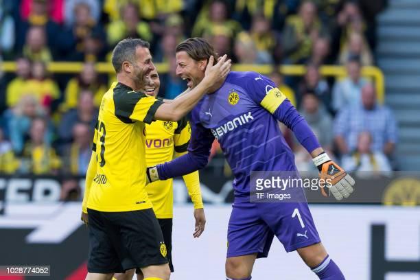 Alex Frei of Borussia Dortmund Allstars shakes hands with Roman Weidenfeller during the Roman Weidenfeller Farewell Match between BVB Allstars and...