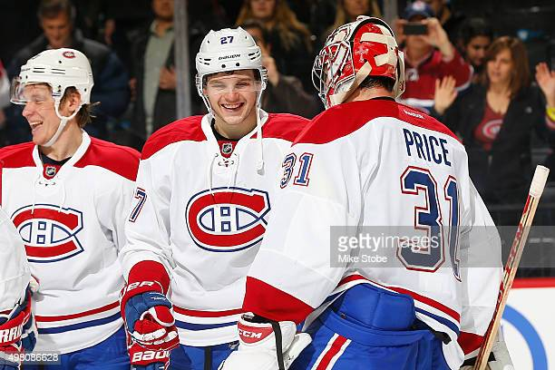 Alex Galchenyuk and Carey Price celebrate the Montreal Canadiens' win against the New York Islanders at the Barclays Center on November 20, 2015 in...