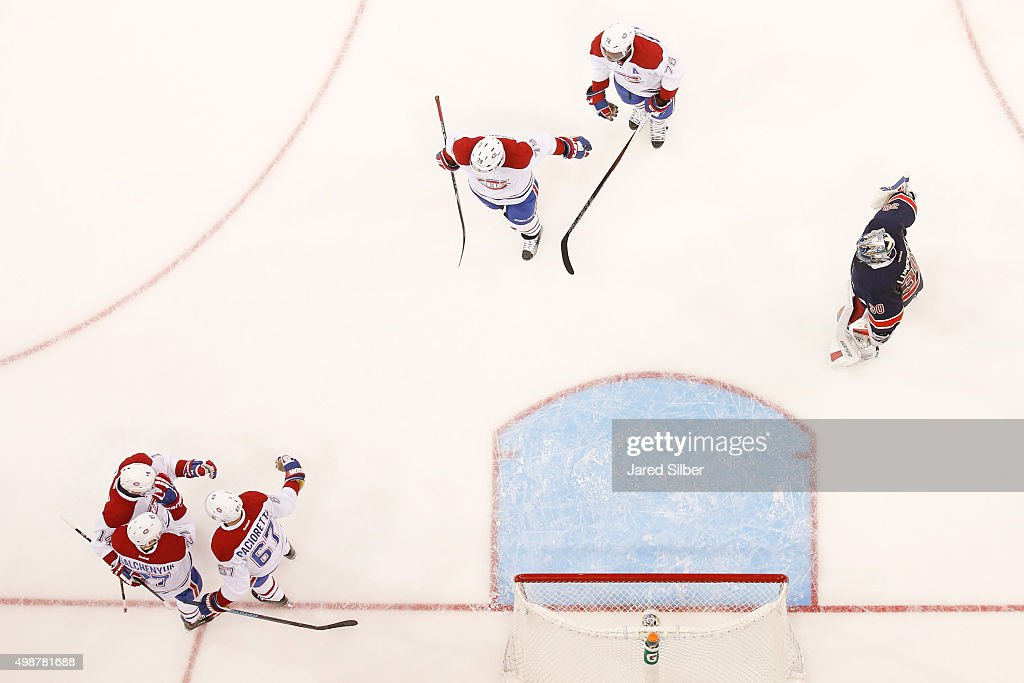 Alex Galchenyuk #27, Max Pacioretty #67 and Tomas Plekanec #14 of the Montreal Canadiens celebrate after a third period goal against Henrik Lundqvist #30 of the New York Rangers at Madison Square Garden on November 25, 2015 in New York City.