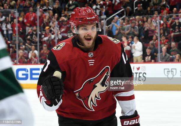 Alex Galchenyuk of the Arizona Coyotes celebrates as he skates back to the bench after scoring a goal against the Minnesota Wild during the first...