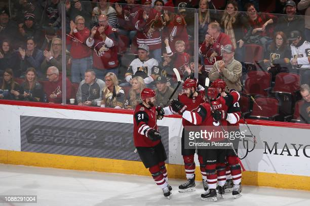 Alex Galchenyuk of the Arizona Coyotes celebrates with Derek Stepan Clayton Keller and Oliver EkmanLarsson after scoring a powerplay goal against the...
