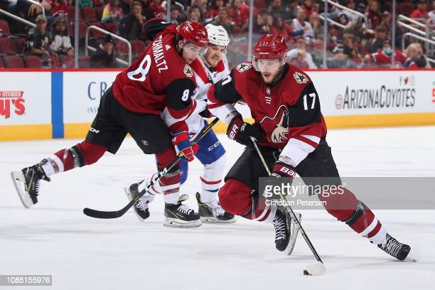 Alex Galchenyuk of the Arizona Coyotes skates with the puck ahead of Nick Schmaltz and Andrew Shaw of the Montreal Canadiens during the third period...
