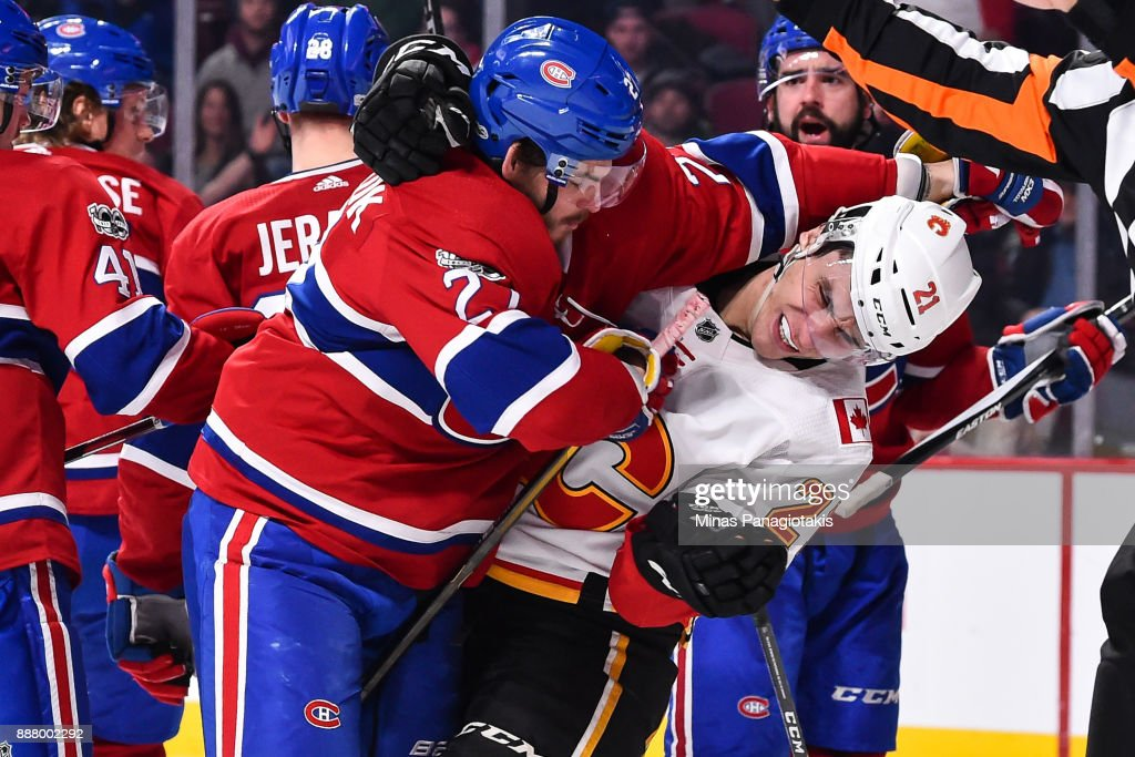 Alex Galchenyuk #27 of the Montreal Canadiens battles it out with Garnet Hathaway #21 of the Calgary Flames during the NHL game at the Bell Centre on December 7, 2017 in Montreal, Quebec, Canada. The Calgary Flames defeated the Montreal Canadiens 3-2 in overtime.