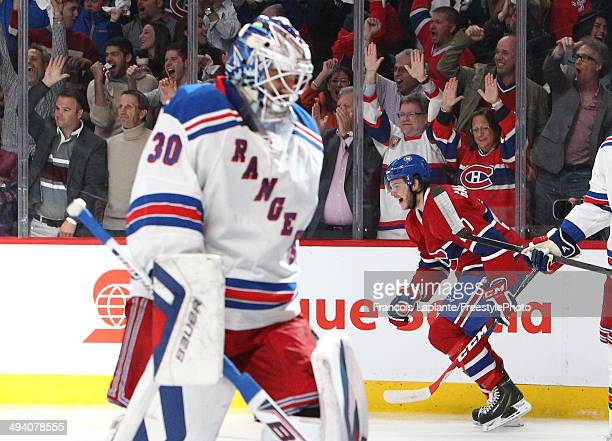 Alex Galchenyuk of the Montreal Canadiens celebrates his first period power play goal as Henrik Lundqvist of the New York Rangers looks on during...