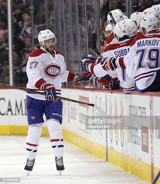 Alex Galchenyuk of the Montreal Canadiens celebrates his goal in second period action in an NHL game against the Winnipeg Jets at the MTS Centre on...