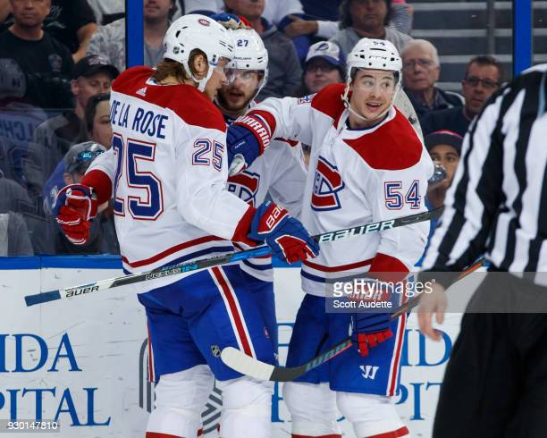 Alex Galchenyuk of the Montreal Canadiens celebrates his goal with teammates Jacob de la Rose and Charles Hudon during the second period against the...