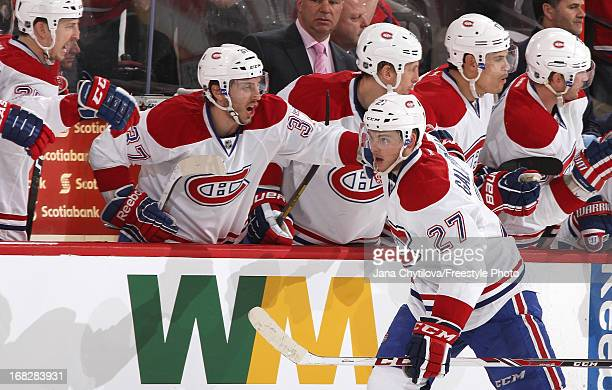 Alex Galchenyuk of the Montreal Canadiens celebrates his second period goal with team mates Gabriel Dumont and Rene Bourque against the Ottawa...