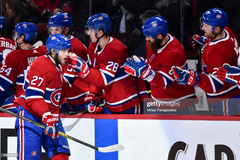 Alex Galchenyuk #27 of the Montreal Canadiens celebrates his third period goal with teammates on the bench against the Detroit Red Wings during the NHL game at the Bell Centre on March 26, 2018 in Montreal, Quebec, Canada. The Montreal Canadiens defeated the Detroit Red Wings 4-2.