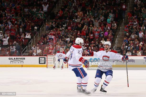 Alex Galchenyuk of the Montreal Canadiens celebrates with Phillip Danault after scoring the game winning goal against the Arizona Coyotes following...