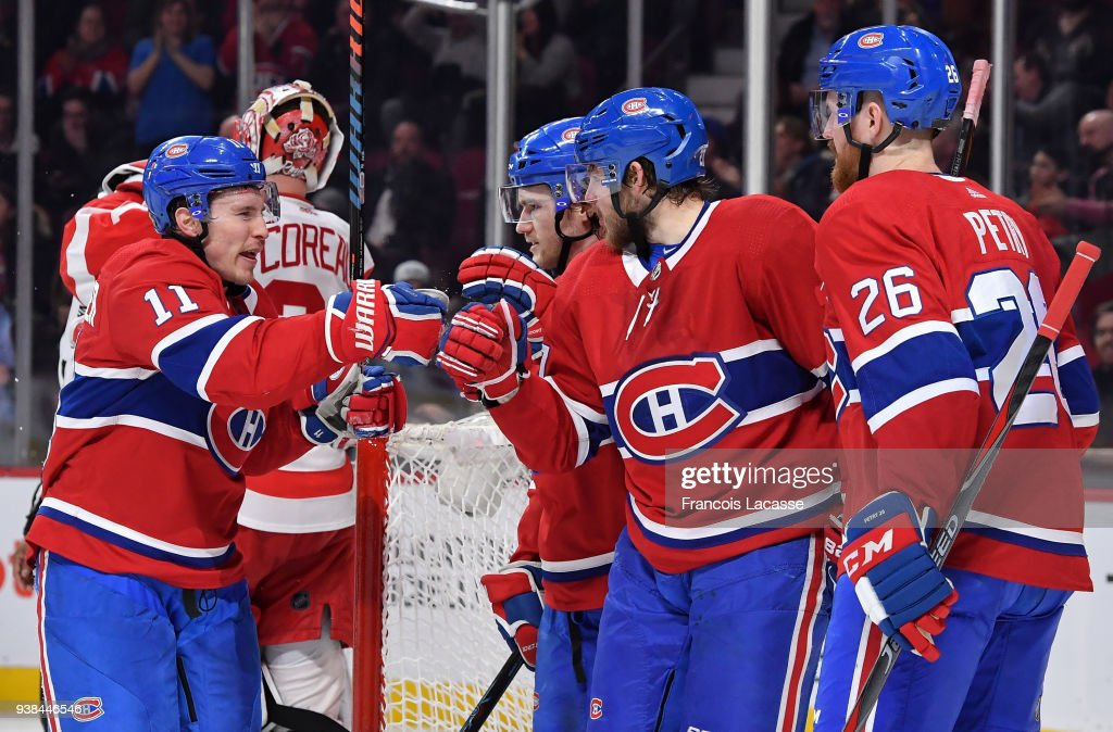 Alex Galchenyuk #27 of the Montreal Canadiens celebrates with teammates after scoring a goal against the Detroit Red Wings in the NHL game at the Bell Centre on March 26, 2018 in Montreal, Quebec, Canada.