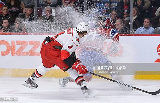 Alex Galchenyuk of the Montreal Canadiens controls the puck and skates wide as Jamie McBain of the Carolina Hurricanes pressure during the NHL game...