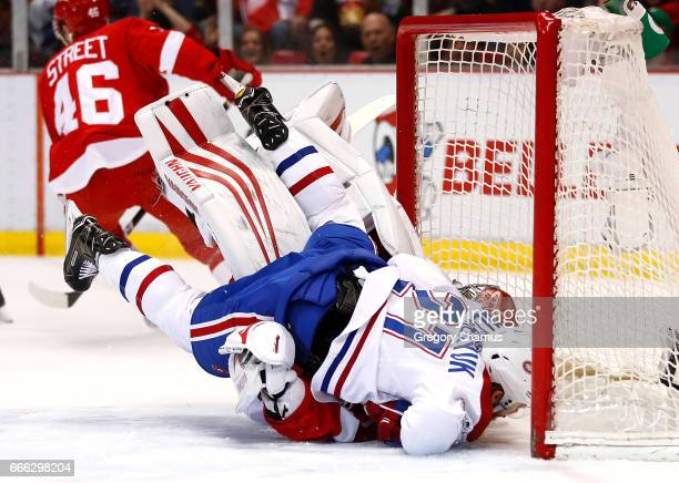Alex Galchenyuk of the Montreal Canadiens crashes into Petr Mrazek of the Detroit Red Wings during the first period at Joe Louis Arena on April 8...