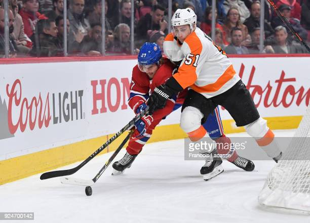 Alex Galchenyuk of the Montreal Canadiens fights for the puck against Valtteri Filppula the Philadelphia Flyers in the NHL game at the Bell Centre on...