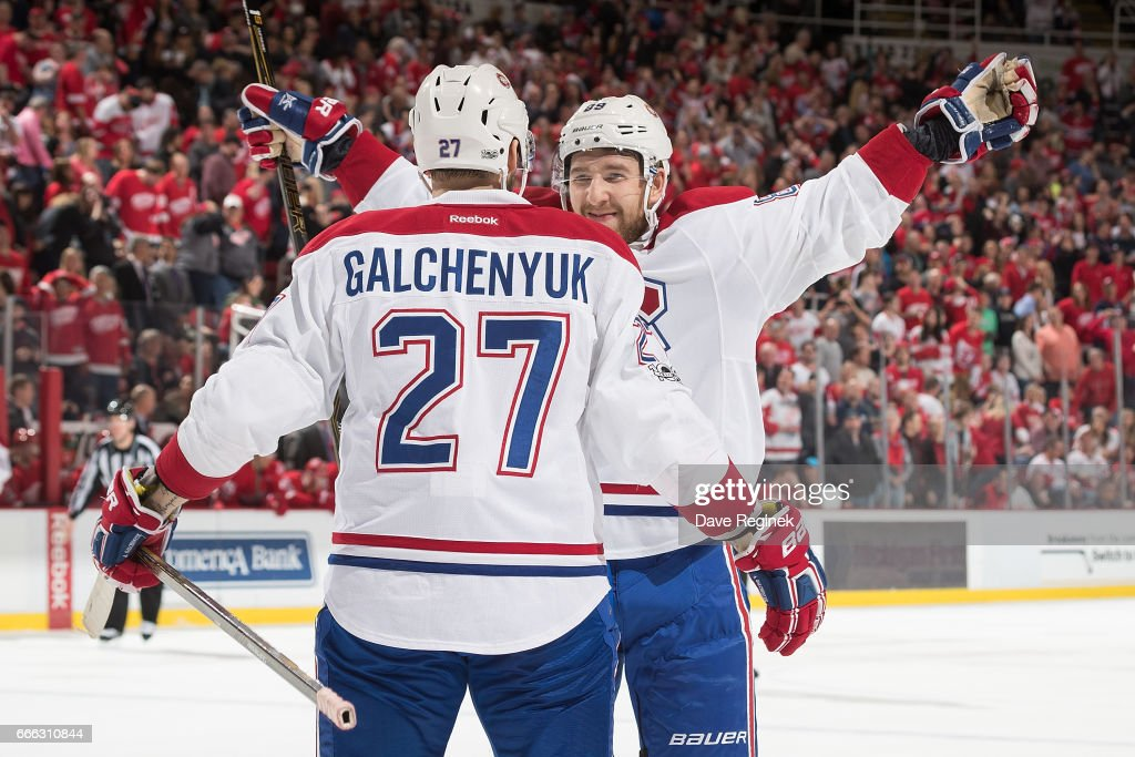 Alex Galchenyuk #27 of the Montreal Canadiens is congratulated following his overtime goal by teammate Nikita Nesterov #89 following an NHL game against the Detroit Red Wings at Joe Louis Arena on April 8, 2017 in Detroit, Michigan. The Canadiens defeated the Wings 3-2 in overtime.