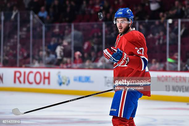 Alex Galchenyuk of the Montreal Canadiens juggles the puck during the warmup prior to the NHL game against the Vancouver Canucks at the Bell Centre...