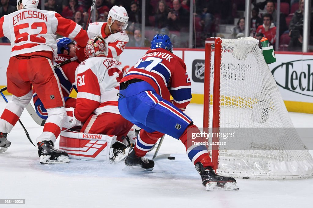 Alex Galchenyuk #27 of the Montreal Canadiens scores a goal on goaltender Jared Coreau #31 of the Detroit Red Wings in the NHL game at the Bell Centre on March 26, 2018 in Montreal, Quebec, Canada.