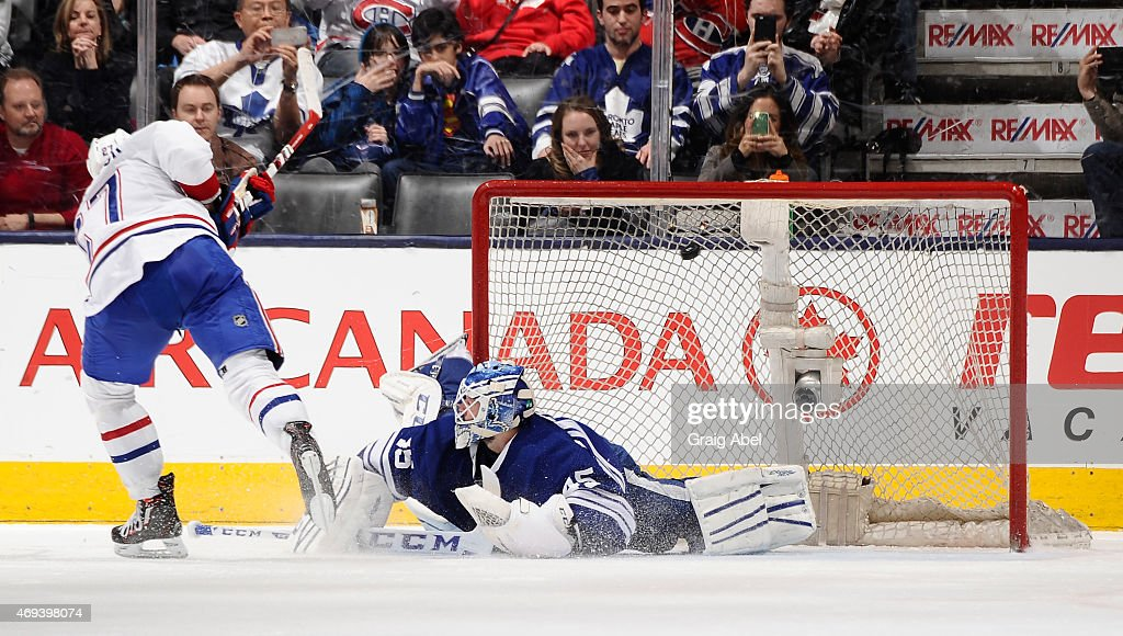 Alex Galchenyuk #27 of the Montreal Canadiens scores a shoot-out goal on Jonathan Bernier #45 of the Toronto Maple Leafs during NHL game action April 11, 2015 at the Air Canada Centre in Toronto, Ontario, Canada.