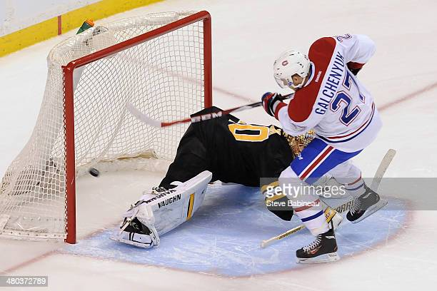 Alex Galchenyuk of the Montreal Canadiens scores and wins in a shootout against Tuukka Rask of the Boston Bruins at the TD Garden on March 24 2014 in...