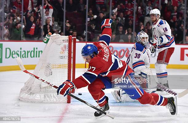 Alex Galchenyuk of the Montreal Canadiens scores the first goal on goalie Henrik Lundqvist of the New York Rangers in the first period in Game Five...