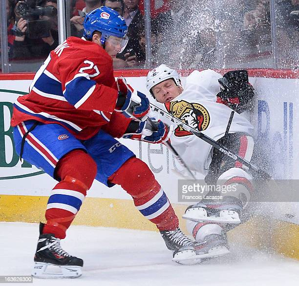 Alex Galchenyuk of the Montreal Canadiens sends Marc Methot of the Ottawa Senators hard into the boards during the NHL game on March 13 2013 at the...