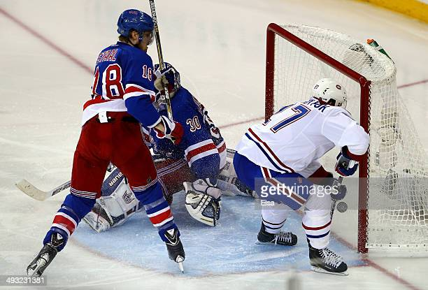 Alex Galchenyuk of the Montreal Canadiens shoots the puck past Henrik Lundqvist of the New York Rangers for the game winning overtime goal in Game...