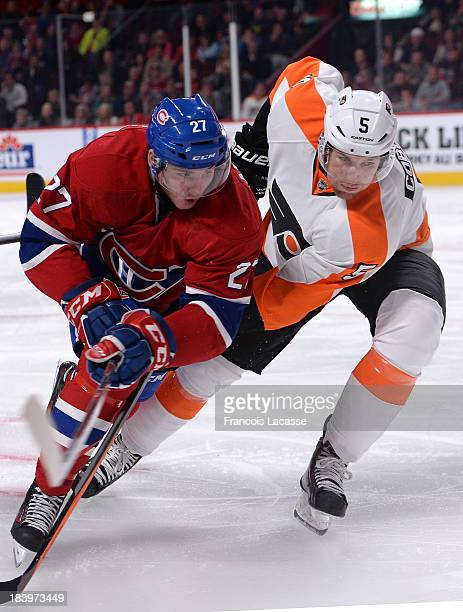 Alex Galchenyuk of the Montreal Canadiens skates with the puck against Braydon Coburn of the Philadelphia Flyers during the NHL game on October 5...