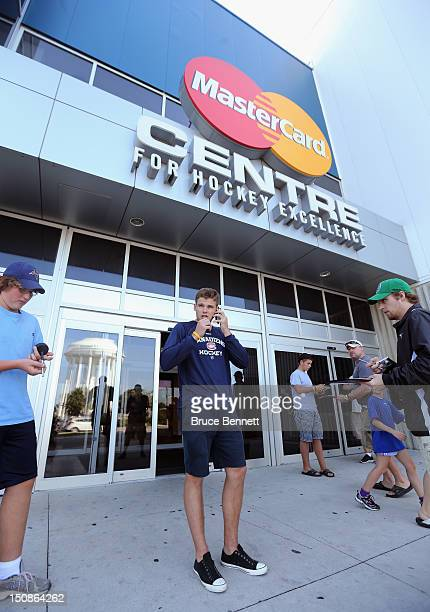 Alex Galchenyuk of the Montreal Canadiens speaks on the phone following a media opportunity at the 2012 NHLPA rookie showcase at the MasterCard...