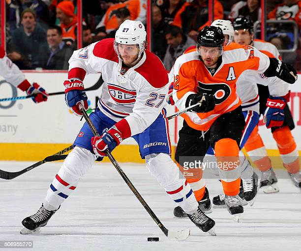 Alex Galchenyuk of the Montreal Canadiens tries to keep the puck from Mark Streit of the Philadelphia Flyers at the Wells Fargo Center on January 5...