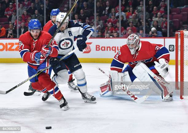 Alex Galchenyuk of the Montreal Canadiens tries to keep the puck from Mark Scheifele of the Winnipeg Jets in the NHL game at the Bell Centre on...