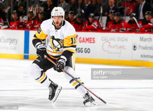 Alex Galchenyuk of the Pittsburgh Penguins playing in his 500th NHL game skates against the New Jersey Devils during the game at the Prudential...