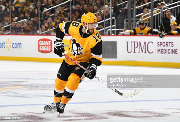 Alex Galchenyuk of the Pittsburgh Penguins skates against the Columbus Blue Jackets at PPG PAINTS Arena on October 5 2019 in Pittsburgh Pennsylvania