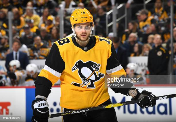 Alex Galchenyuk of the Pittsburgh Penguins skates against the Boston Bruins at PPG PAINTS Arena on January 19 2020 in Pittsburgh Pennsylvania