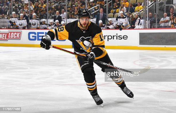 Alex Galchenyuk of the Pittsburgh Penguins skates against the Buffalo Sabres at PPG PAINTS Arena on October 3, 2019 in Pittsburgh, Pennsylvania.