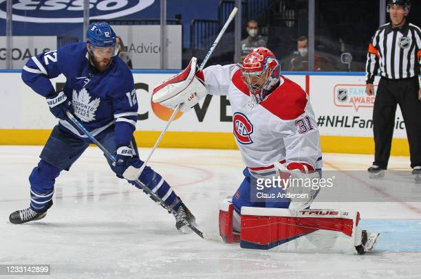 Alex Galchenyuk of the Toronto Maple Leafs tries to tip a shot past Carey Price of the Montreal Canadiens in Game Five of the First Round of the 2021...