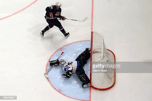 Alex Galchenyuk of USA scores his team's winning goal during penalty shut out during the IIHF World Championship third place match between Finland...