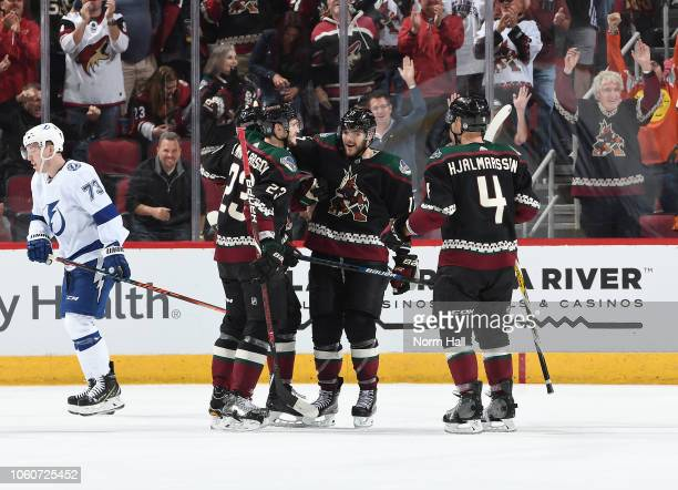 Alex Galchenyuk Oliver EkmanLarsson and Niklas Hjalmarsson of the Arizona Coyotes celebrate a goal against the Tampa Bay Lightning at Gila River...