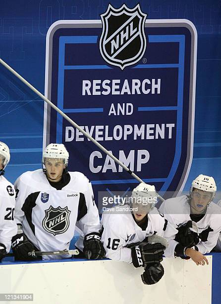Alex Galchenyuk Scott Kosmachuk and Miles Koules all of Team White watch action against Team Black during the NHL Research Development and...